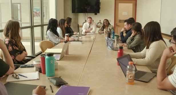 Students gather for the University of Denver's immigration law clinic