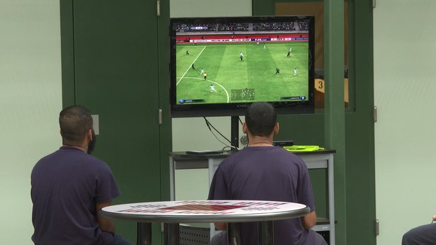 ICE detainees shown playing video games inside the detention center