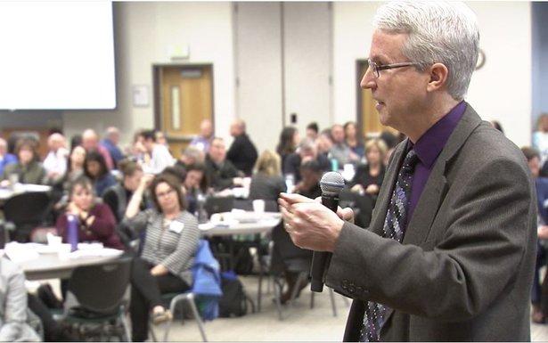 Dr. Peter Langman teaches Colorado educators about warning signs.JPG