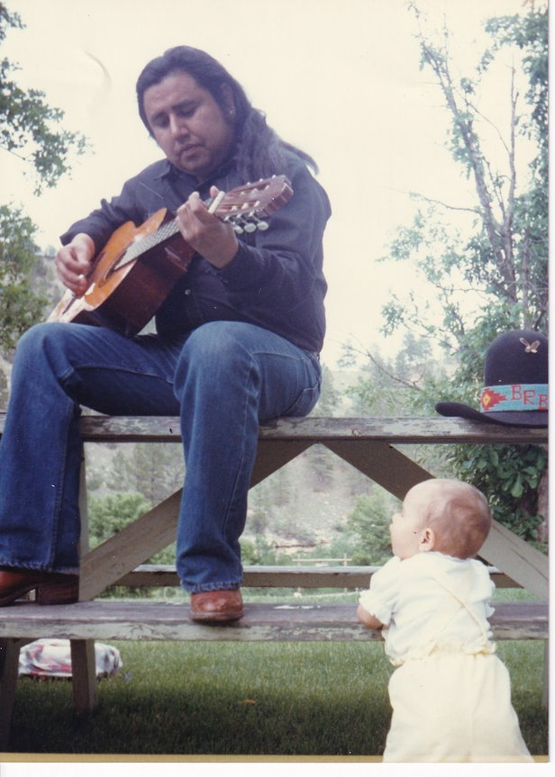 buddy playing guitar with stardust picnic bench.jpg