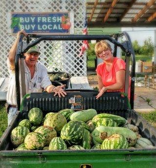 Sam and Heidi Heikes with their watermelon crop.