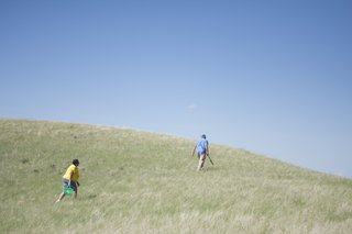 Jhon and Geraldine Goes in Center cross the prairie looking for timpsila.