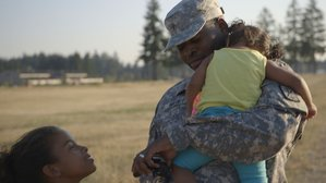At Joint Base Lewis-McChord, a family enjoys their last moments together before a nine-month deployment.
