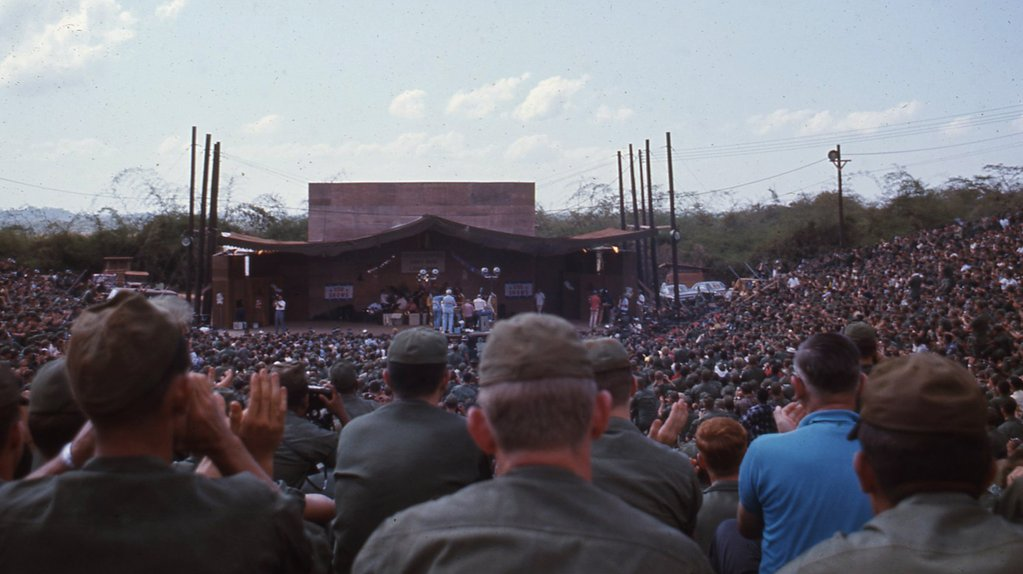 Service members watch Bob Hope perform for the troops in Vietnam.