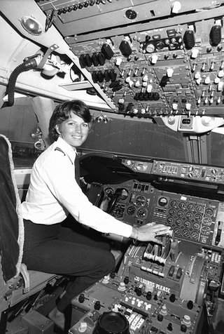 Lynn in the cockpit of a plane.