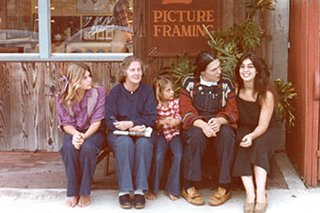 Zoe sitting outside the Magic Speller bookshop with friends.