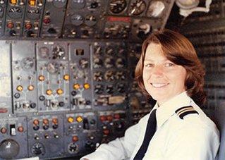 Lynn Rippelmeyer as pilot in cockpit.