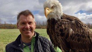 Chris Kratt with a bald eagle.