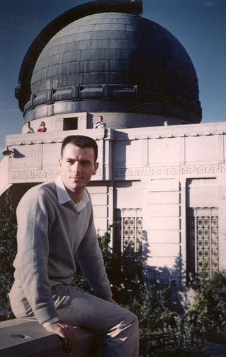 Gary Flandro seated in front of an observatory