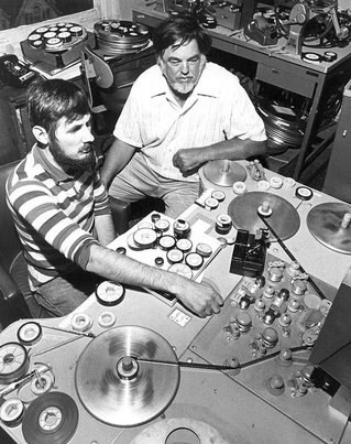 Alan Lomax and recording engineer in recording studio