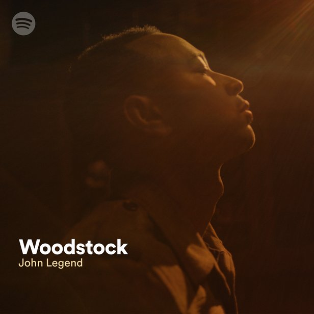 "A promotional image of John Legend with the text ""John Legend - Woodstock"""