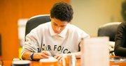 image boy at desk