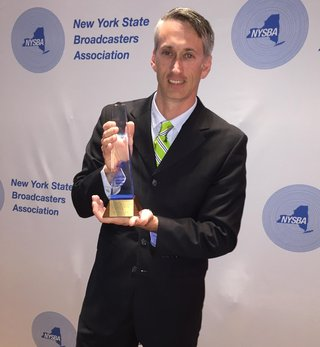 Matt Ryan holding NYSBA Award