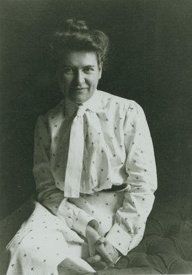Seated studio portrait of Willa Cather in Pittsburgh.